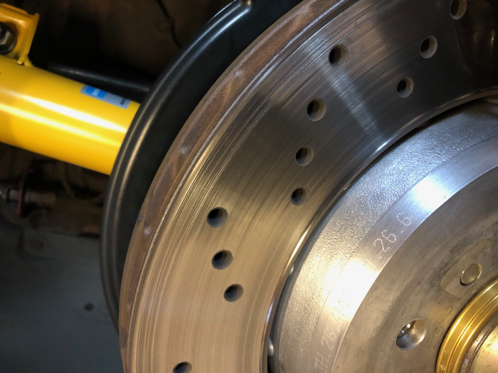 Name:  Red Roadster Wheel Hub Cleaning After.jpg Views: 458 Size:  664.2 KB